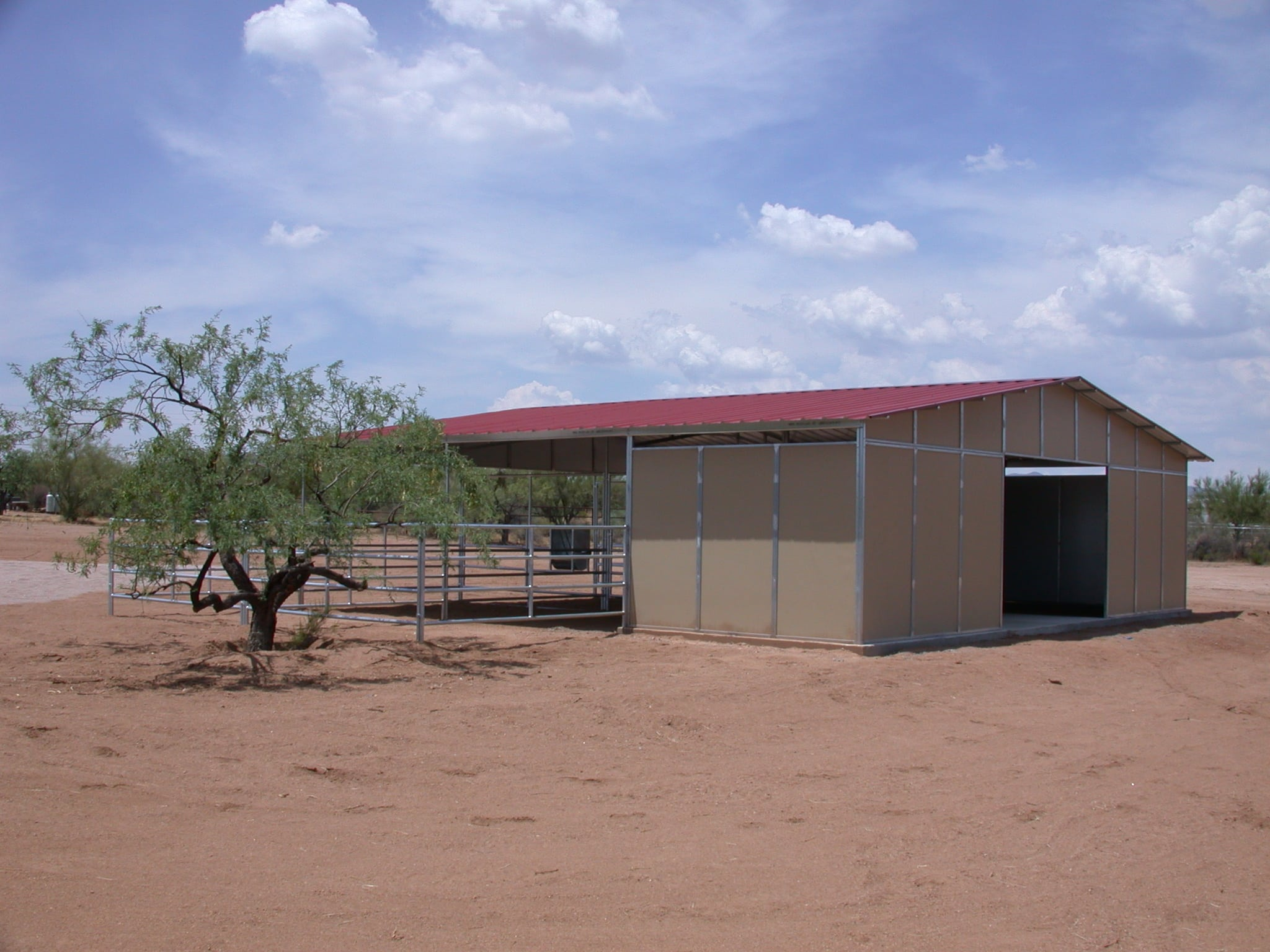 combo barn with pipe panels, pipe stalls, tack rooms, hay bays horse barn