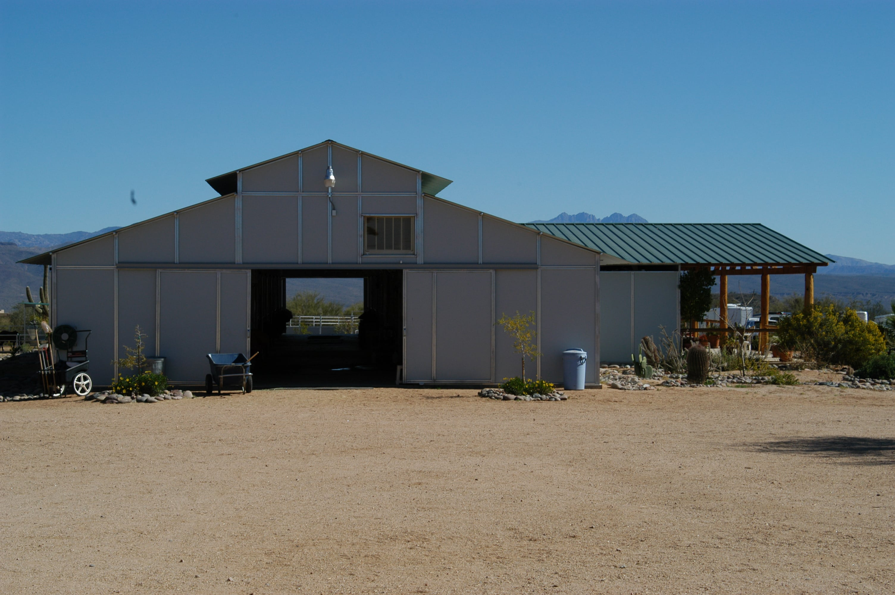 RCA 12' x 12' stalls 16' raised center aisle, with side porch, evaporator cooler helping with summer heat.