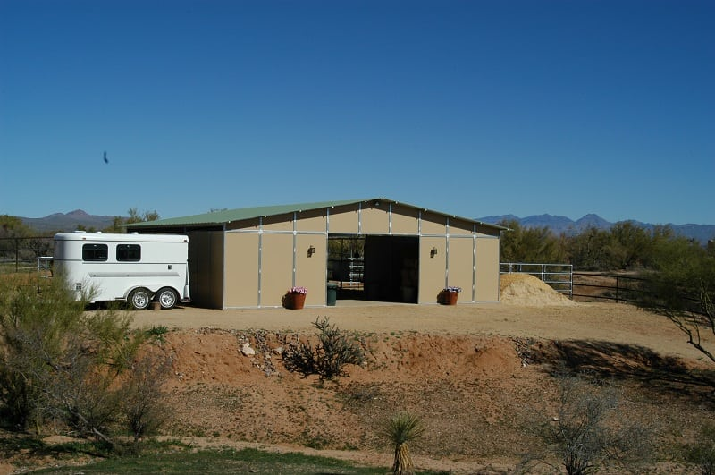 36' wide breezeway barn: 12' x 12' stalls, with interior pipe panels solid wall tack room, and exterior. Solid walls.